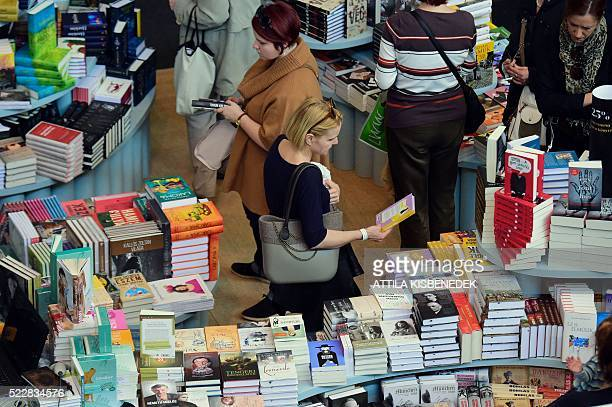 World book fair fotografas e imgenes de stock getty images people check out books at a stand at the 23rd international book festival in the millenaris gumiabroncs Image collections