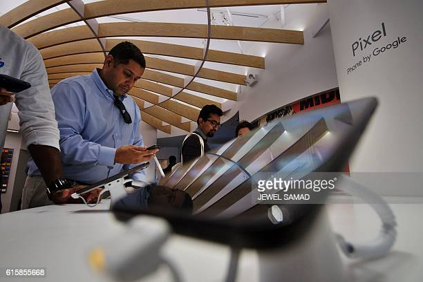 People check out Google phones after the opening of Google's popup store in New York on October 20 2016 Google opened its first retail store which is...