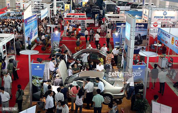 People check out new cars at the 2006 Vietnam Car Expo in Hanoi Vietnam on Sunday August 20 2006
