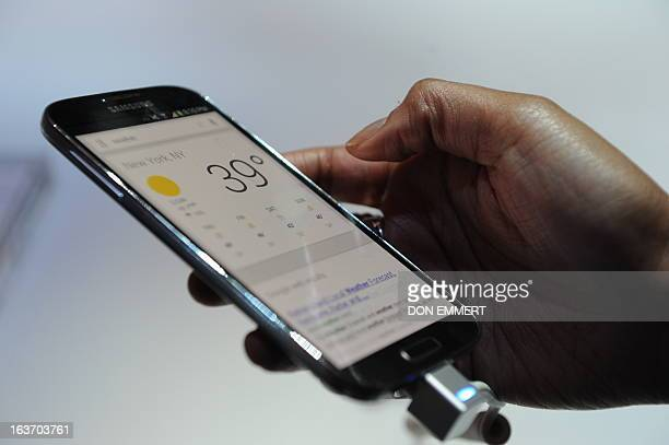 People check out Samsung's new Galaxy S4 during its unveiling on March 14, 2013 at Radio City Music Hall in New York. The slim, feature-rich Galaxy...