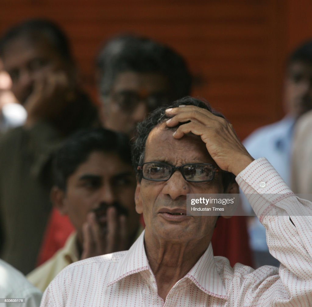 People check out the live index after the Bombay Stock Exchange (BSE) Sensex collapsed by 366 points in Mumbai on Wensday.