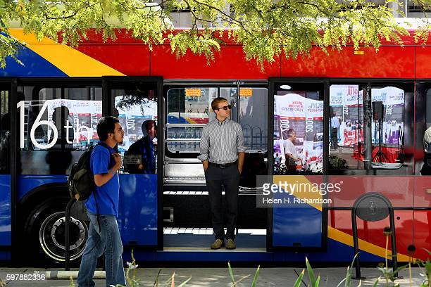 People check out the new 16th Street Free MallRide bus on display at Skyline Park on the 16th street mall on August 29 2016 in Denver Colorado A...