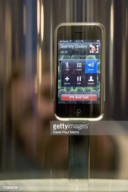 People check out the new iPhone on display at MacWorld on January 10 2007 in San Francisco California The device which is controlled by a touch...