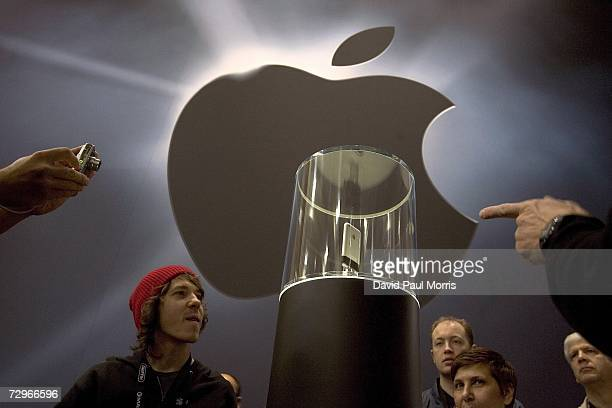 People check out the new iPhone on display at MacWorld on January 10, 2007 in San Francisco, California. The device which is controlled by a touch...