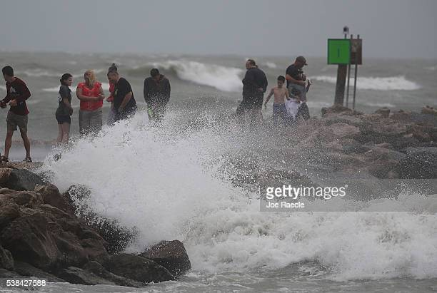 People check out the waves from Tropical Storm Colin on June 6 2016 in Venice Florida Florida Gov Rick Scott declared a state of emergency as Colin...