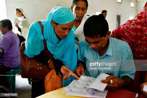 People check their names on the final list of the National Register of Citizens at Buraburi village in Morigaon district of Assam on August 31, 2019....