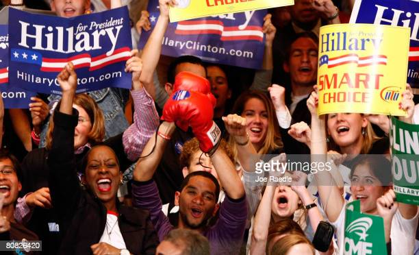 People cheer after CNN projected Democratic presidential hopeful Sen Hillary Clinton the winner as they wait for her to appear during her primary...