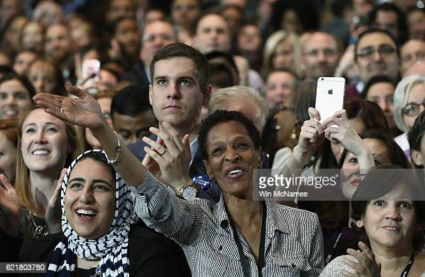 People cheer as as its projected that Democratic presidential nominee former Secretary of State Hillary Clinton won New York state during her...