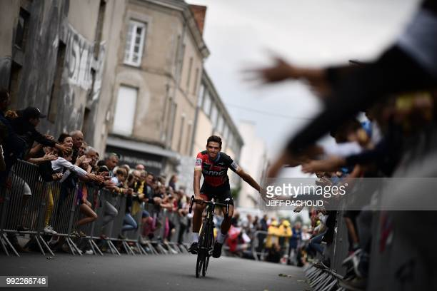 People cheer as Belgium's Greg Van Avermaet of USA's BMC Racing cycling team cycles past during the team presentation ceremony on July 5 2018 in La...