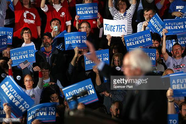 People cheer as Democratic presidential candidate Sen Bernie Sanders speaks onstage after victory over Hillary Clinton in the New Hampshire primary...