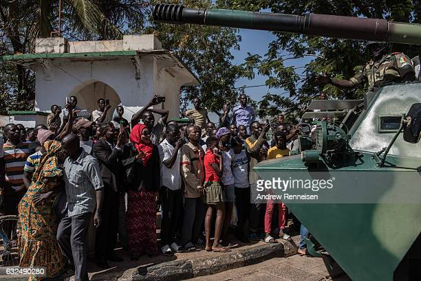 People cheer as ECOWAS troops from Senegal gather outside the Gambian statehouse on January 23 2017 in Banjul The Gambia ECOWAS is in Gambia to...