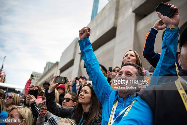 People cheer as Meb Keflezighi an American wins the Boston Marathon on April 21 2014 in Boston Massachusetts Today marks the 118th Boston Marathon...