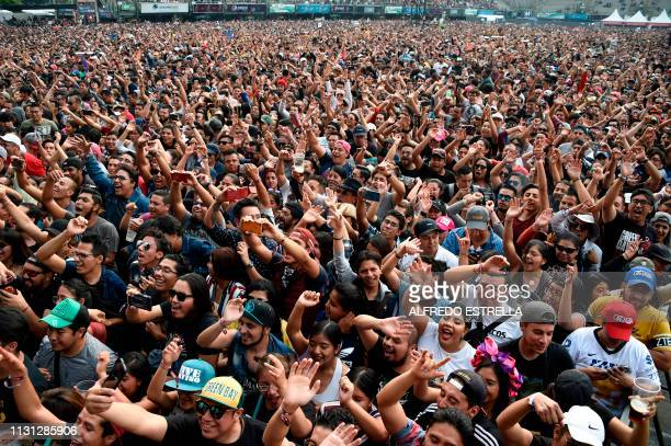 People cheer as Mexican band El Gran Silencio performs during the second day of the 'Vive Latino' music festival in Mexico City on March 17 2019