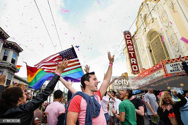 People cheer as pink confetti falls from the sky during a gay pride celebration on June 27 2015 in San Francisco California The Supreme Court ruled...