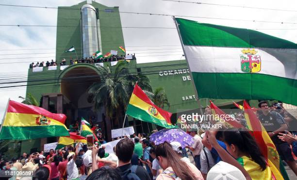 People cheer as policemen demonstrate at their headquarters in Santa Cruz, in eastern Bolivia, on November 9, 2019 after joining a rebellion launched...