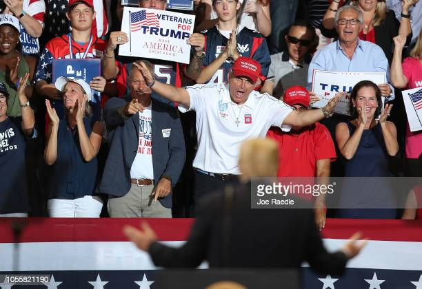 People cheer as President Donald Trump looks at them during a campaign rally at the Hertz Arena to help Republican candidates running in the upcoming...