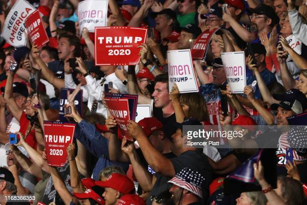 People cheer as President Donald Trump speaks to supporters at a rally in Manchester on August 15, 2019 in Manchester, New Hampshire. The Trump 2020...