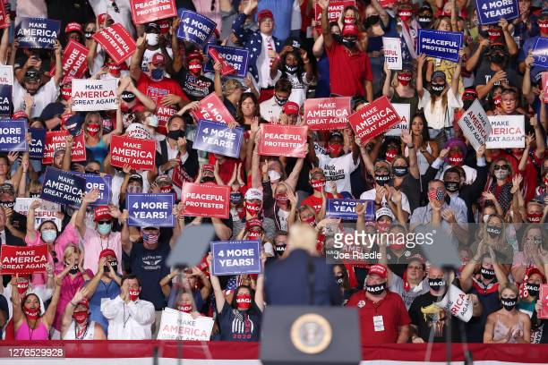People cheer as President Donald Trump turns to face them during his 'The Great American Comeback Rally' at Cecil Airport on September 24 2020 in...