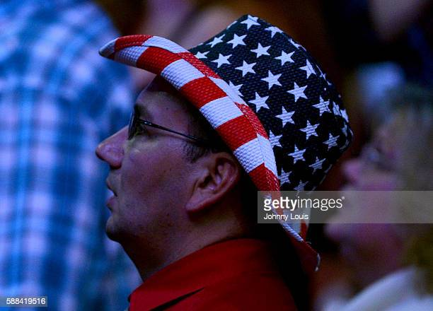 People cheer as Republican presidential nominee Donald Trump speaks during his campaign event at the BBT Center on August 10 2016 in Sunrise Florida