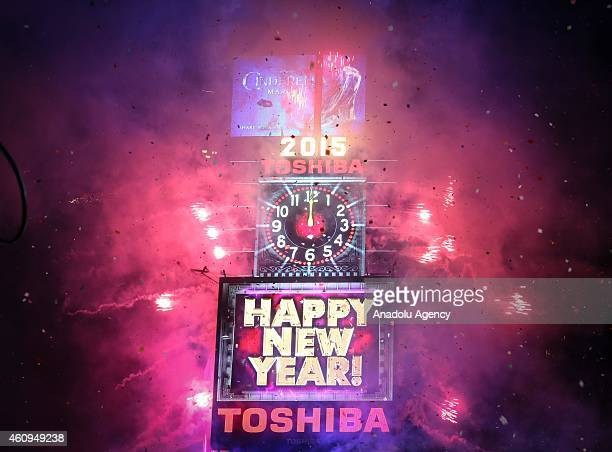 People cheer as the ball drops at midnight in Times Square on January 1 2015 in New York City An estimated one million people assembled on New York's...