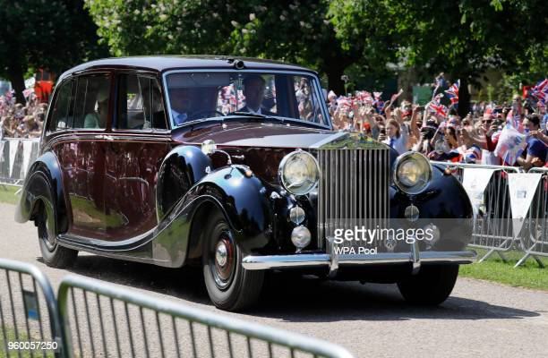 People cheer as the car with Meghan Markle arrives for the wedding ceremony to Prince Harry in Windsor on May 19 2018 in Windsor England
