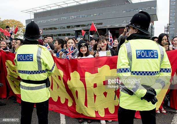 People cheer as the President of the People's Republic of China Xi Jinping tours the National Graphene Institute at Manchester University with the...