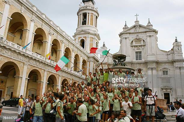 People cheer as they arrive on the square of the Loreto Shrine 31 August 2007. Pope Benedict XVI will arrive to Loreto tomorrow for a meeting with...