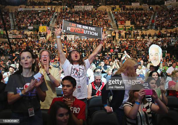 People cheer as they listen to speakers while waiting for former Republican presidential candidate Rep Ron Paul to speak at a rally in the Sun Dome...