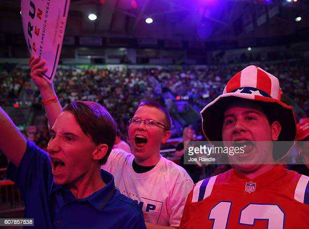 People cheer as they wait the arrival of Republican presidential candidate Donald Trump during a campaign rally at the Germain Arena on September 19...