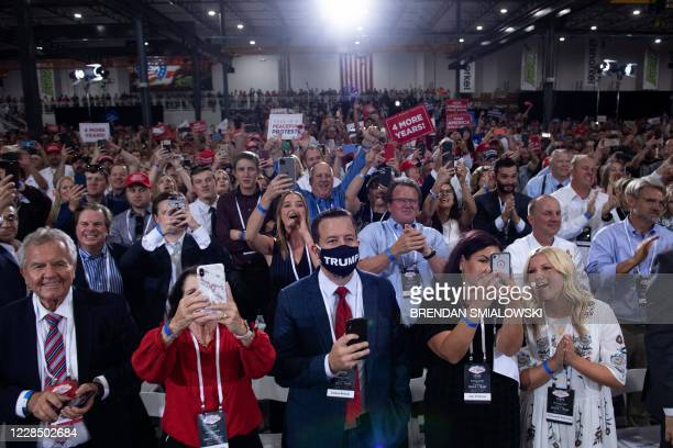 People cheer as US President Donald Trump arrives for an indoor campaign rally at Xtreme Manufacturing in Henderson a suburb of Las Vegas Nevada on...
