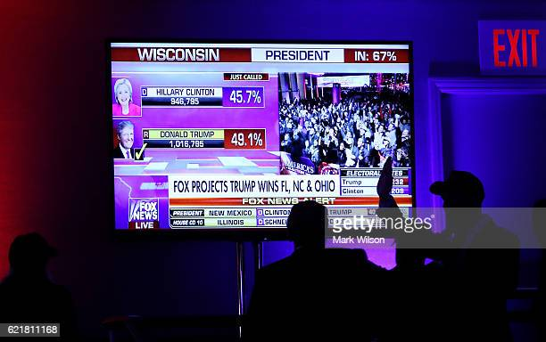 People cheer as voting results for Wisconsin come in at Republican presidential nominee Donald Trump's election night event at the New York Hilton...