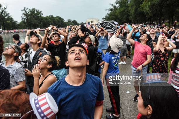 People cheer during a fly over on the National Mall during President Donald Trump's speech during Fourth of July festivities on July 4 2019 in...