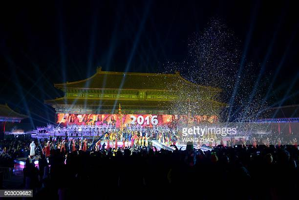 People cheer during a New Year's Eve countdown event at the Tai Miao Temple next to the Forbidden City in Beijing on January 1 2016 / AFP / WANG ZHAO