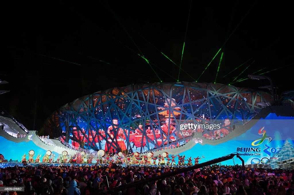 People cheer during a New Year's eve countdown event to ...