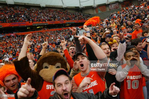 People cheer during the game between the Georgetown University Hoyas and the Syracuse Orange at the Carrier Dome February 16 2008 in Syracuse New York