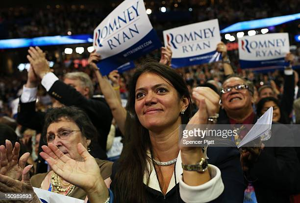 People cheer during the program during the third day of the Republican National Convention at the Tampa Bay Times Forum on August 29 2012 in Tampa...