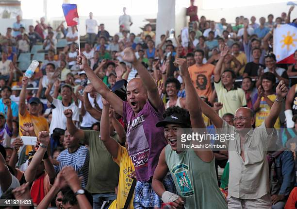 People cheer during the public viewing of the WBO International Welterweight title bout of the Philippine's hero boxer Manny Pacquiao who had told to...