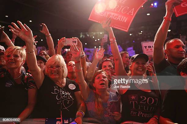 People cheer for Republican presidential candidate Donald Trump as he speaks during a campaign rally at the Germain Arena on September 19 2016 in...