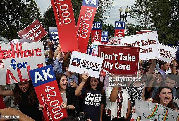 People cheer in front of the US Supreme Court after after ruliing was announced on the Affordable Care Act. June 25, 2015 in Washington, DC. The high...