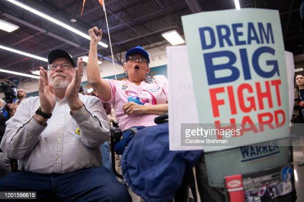 People cheer on Democratic presidential candidate Elizabeth Warren, D-Mass., as she speaks at a Mi Familia Vota community event in Las Vegas on...
