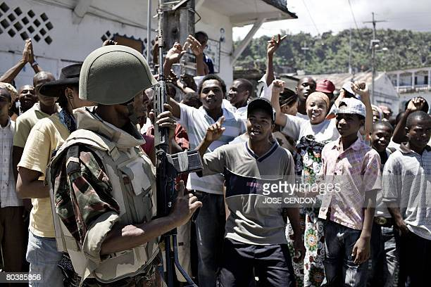 People cheer the Comoran and African Union troops in Mutsamudu the capital of Anjouan on March 26 2008 Comoran and African forces on Wednesday...