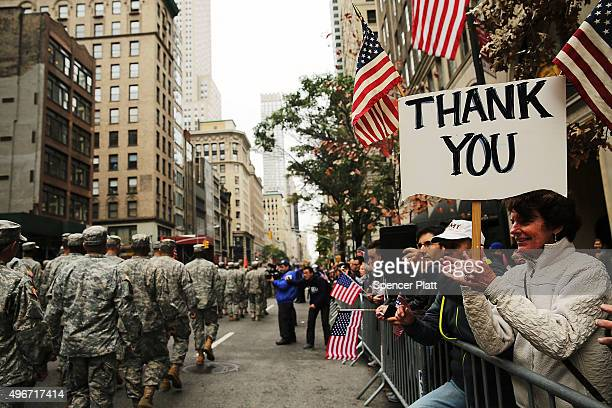 People cheer veterans in the nation's largest Veterans Day Parade in New York City on November 11 2015 in New York City Known as 'America's Parade'...