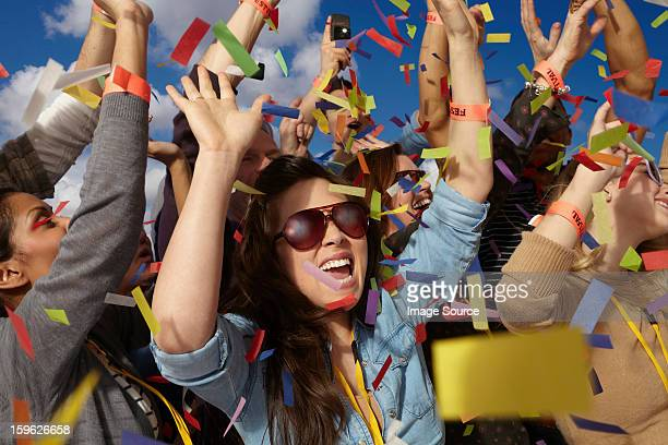 people cheering at a music festival - ticker tape stock photos and pictures