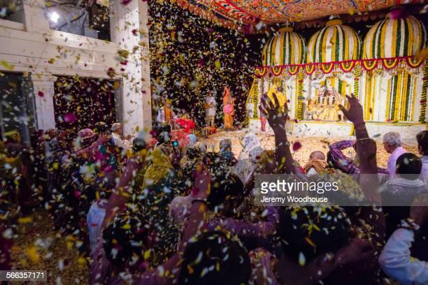 People cheering at Holi Festival, Vrindavan, Uttar Pradesh, India