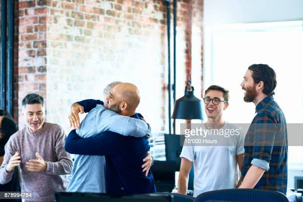 people cheering in modern office - good news stock pictures, royalty-free photos & images