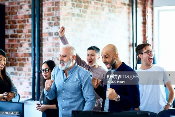people cheering in modern office - chanting stock pictures, royalty-free photos & images