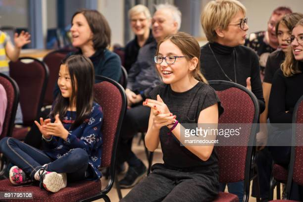 """people cheering teams playing leisure games at family celebrations. - """"martine doucet"""" or martinedoucet foto e immagini stock"""