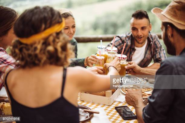 people cheering with orange juice - guest stock pictures, royalty-free photos & images