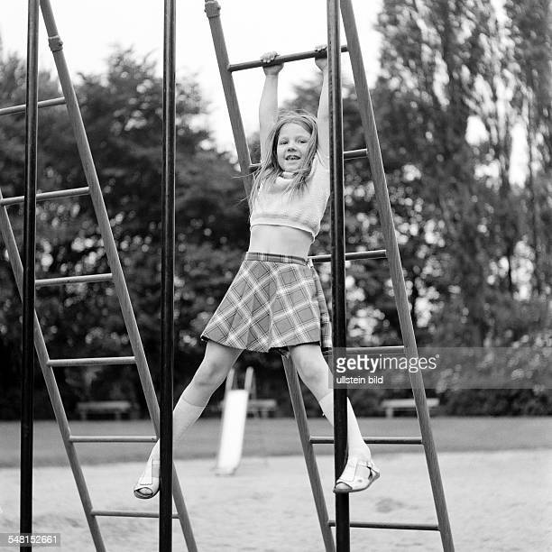 People, children, little girl on monkey bars, childrens playground, aged 5 to 7 years -