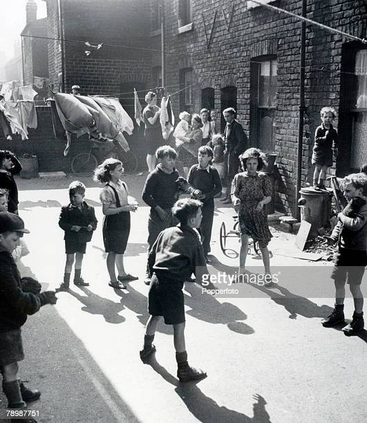 April 1947 Children playing at Hope Square Sheffield at the back of Bright Side Lane where houses had no bathrooms and had outside toilets but still...